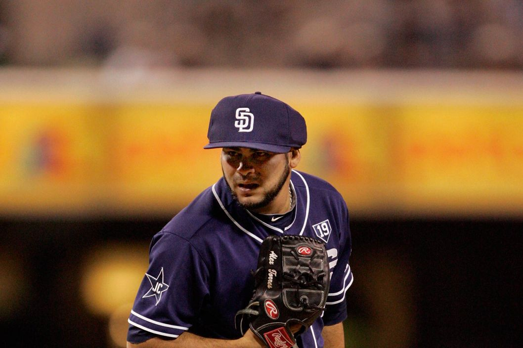 Pitcher Alex Torres #54 of the San Diego Padres wearing a protective cap prepares to throw the ball in the 6th inning of the game against the Arizona Diamondbacks at Petco Park on June 28, 2014 in San Diego, California.