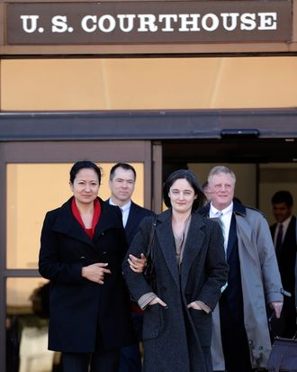 Couples Cleopatra De Leon, front left, and partner, Nicole Dimetman, front right, and Victor Holmes, back left, and partner Mark Phariss, back right, leave the U.S. Federal Courthouse, Wednesday, Feb. 12, 2014, in San Antonio. The two homosexual couples are challenging Texas' ban on same-sex marriage and have taken their case to federal court.