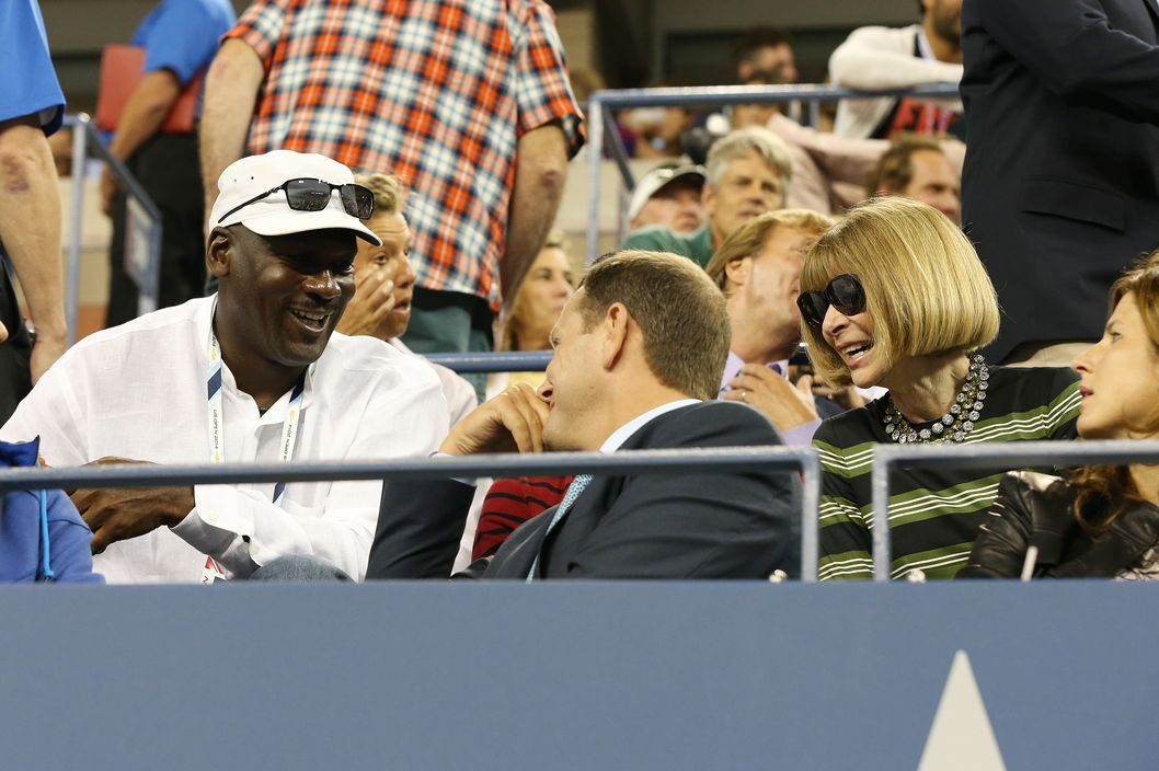 NEW YORK, NY - AUGUST 26: Michael Jordan chats with Tony Godsick (Federer's agent) and Anna Wintour during Roger Federer's match on Day 2 of the 2014 US Open at USTA Billie Jean King National Tennis Center on August 26, 2014 in the Flushing neighborhood of the Queens borough of New York City. (Photo by Jean Catuffe/GC Images)