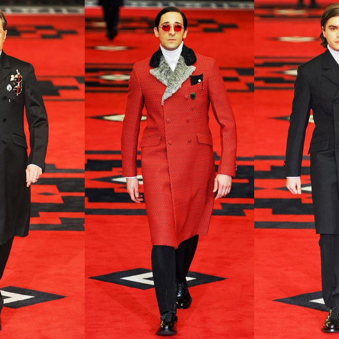 From left: Gary Oldman, Adrien Brody, and Emile Hirsch on the Prada menswear runway.