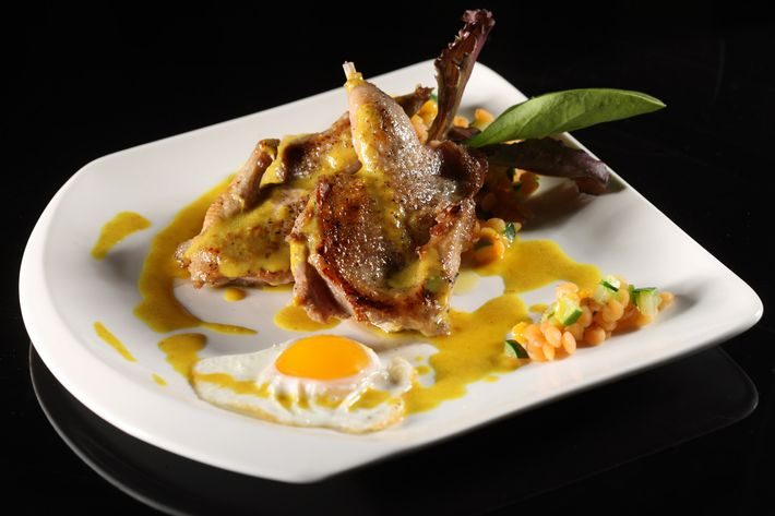 Quail with orange lentils, zucchini, and turmeric jus.