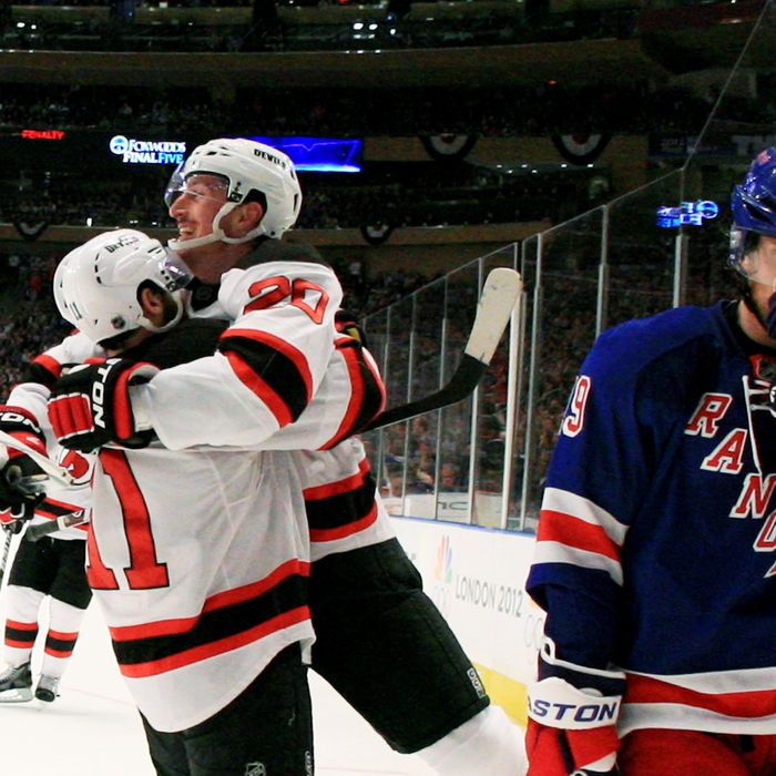 NEW YORK, NY - MAY 23: Ryan Carter #20 of the New Jersey Devils celebrates his third period goal with Stephen Gionta #11 as Brad Richards #19 of the New York Rangers reacts in Game Five of the Eastern Conference Final during the 2012 NHL Stanley Cup Playoffs at Madison Square Garden on May 23, 2012 in New York City. (Photo by Bruce Bennett/Getty Images)