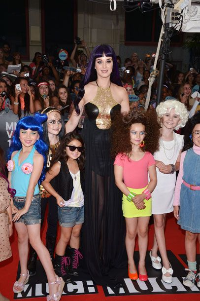 <b>When:</b> June 2012     <b>Where:</b> MuchMusic Movie Awards     <b>What:</b> Katy herself looks like she just fell out of an unseen <i>Indiana Jones </i>follow-up, and we are mildly terrified by what she's wrought upon that poor, innocent posse of Petite Perrys. It's no surprise that her childlike penchant for glitter and pink makes more sense on <i>actual</i> children, but it's highly questionable to put a cupcake bra with cherry nipples on a kid who probably still hasn't noticed that Ken isn't anatomically correct.