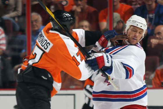 PHILADELPHIA, PA - SEPTEMBER 26: Sean Avery #16 of the New York Rangers is hit by Wayne Simmonds #17 of the Philadelphia Flyers during an NHL preseason game at Wells Fargo Center on September 26, 2011 in Philadelphia, Pennsylvania.  (Photo by Bruce Bennett/Getty Images)