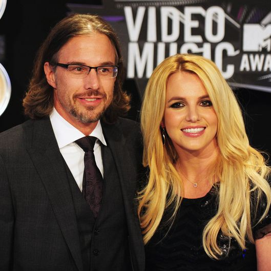 Jason Trawick (L) and Britney Spears arrive at the 2011 MTV Video Music Awards (VMAs) August 28, 2011 at the Nokia Theatre in downtown Los Angeles, California.   AFP PHOTO / Frederic J. Brown (Photo credit should read FREDERIC J. BROWN/AFP/Getty Images)