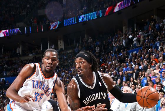 Gerald Wallace #45 of the Brooklyn Nets drives against Kevin Durant #35 of the Oklahoma City Thunder on January 2, 2013 at the Chesapeake Energy Arena in Oklahoma City, Oklahoma.