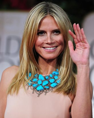 Model Heidi Klum poses on the red carpet for the 69th annual Golden Globe Awards at the Beverly Hilton Hotel in Beverly Hills, California, January 15, 2012.