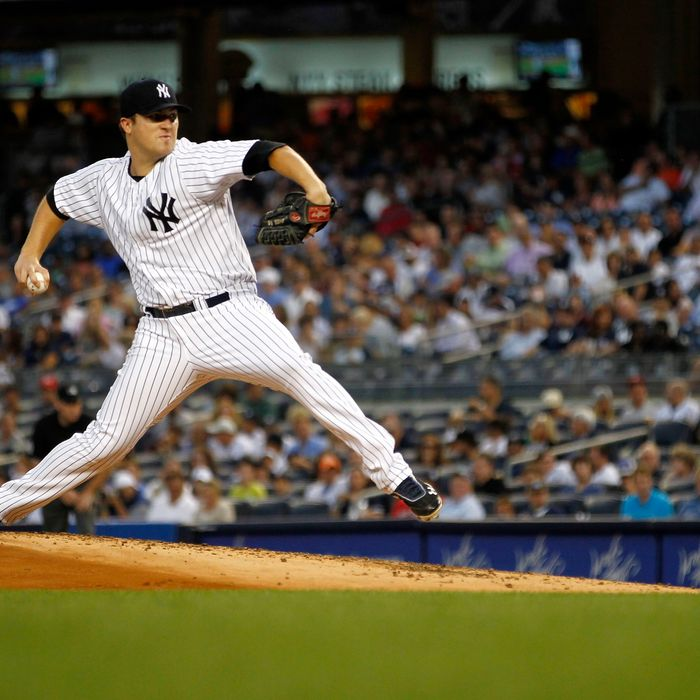 Phil Hughes #65 of the New York Yankees delivers against the Toronto Blue Jays during their game at Yankee Stadium on August 28, 2012 in the Bronx Borough of New York City.
