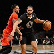 NEW YORK, NY - DECEMBER 25:  Deron Williams #8 of the Brooklyn Nets drives to the basket against D.J. Augustin #14 of the Chicago Bulls during the fourth quarter at the Barclays Center on December 25, 2013 in the Brooklyn borough of New York City. NOTE TO USER: User expressly acknowledges and agrees that, by downloading and/or using this photograph, user is consenting to the terms and conditions of the Getty Images License Agreement. (Photo by Christopher Pasatieri/Getty Images)