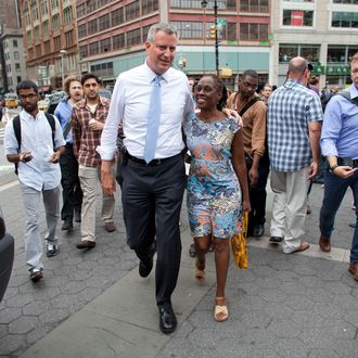 New York City Public Advocate and mayoral candidate Bill de Blasio and his wife Chirlane McCray make an appearance in Union Square in support of fast-food workers during a rally in New York, Thursday August 29, 2013. According to the latest poll by Quinnipiac University, de Blasio is now close to the 40 percent threshold he'd need to avoid a runoff in the Democratic primary.