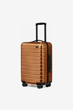 The Carry On Suitcase in Copper by Rashida Jones