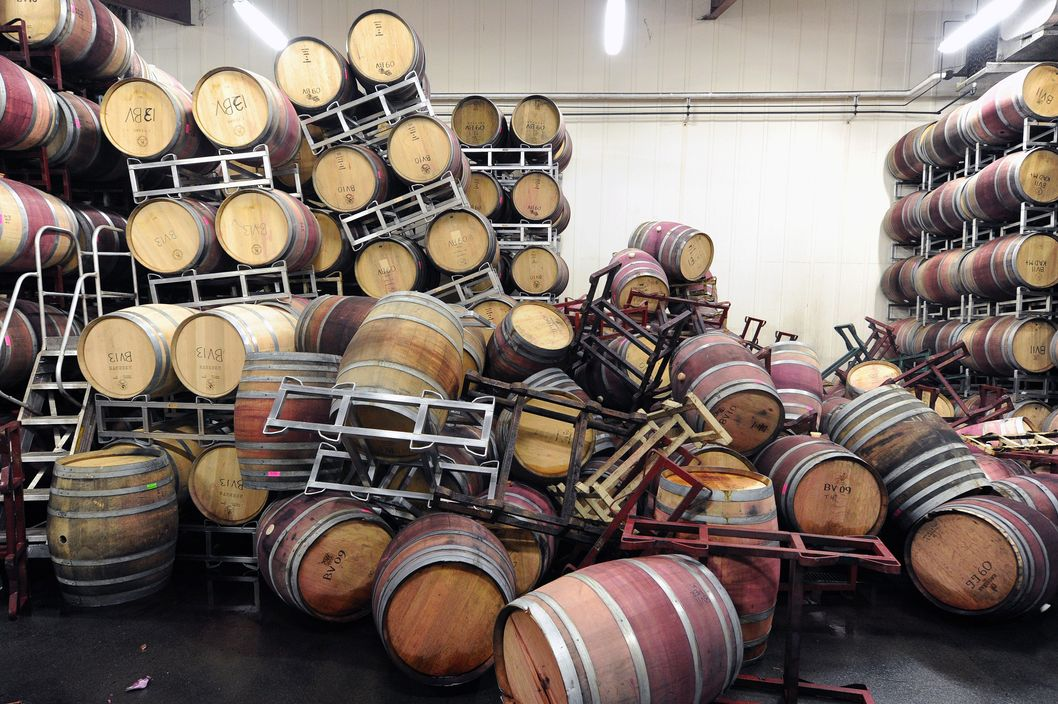 Barrels are strewn about inside the storage room of Bouchaine Vineyards in Napa in downtown Napa, California after an earthquake struck the area. California's governor Jerry Brown declared a state of emergency Sunday following a strong 6.0-magnitude earthquake that seriously injured three people including a child and ignited fires in the scenic Napa valley wine region. The US Geological Service said that the quake was the most powerful to hit the San Francisco Bay area since the 1989 6.9-magnitude Loma Prieta earthquake.