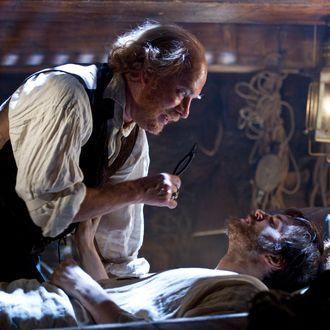 "(L-r) TOM HANKS as Dr. Goose and JIM STURGESS as Adam Ewing in the epic drama ""CLOUD ATLAS"