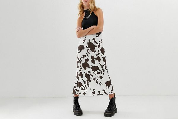 ASOS DESIGN Bias Cut Midi Skirt in Cow Print