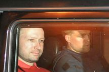 Bomb and terror suspect Anders Behring Breivik (red top) leaves the courthouse in a police car  in Oslo on July 25, 2011, after the hearing to decide his further detention.  Breivik will be held in solitary confinement for the first four weeks, with a ban on all communication with the outside world in a bid to aid a police investigation into his acts. AFP Photo Jon-Are Berg-Jacobsen / Aftenposten (Photo credit should read Jon-Are Berg-Jacobsen/AFP/Getty Images)