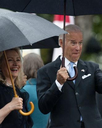 US Vice President Joe Biden points to the crowd alongside Secretary of State Hillary Clinton as US President Barack Obama welcomes South Korean President Lee Myung-bak during a State Arrival Ceremony on the South Lawn of the White House in Washington, DC, on October 13, 2011. Obama hosts his South Korean counterpart for a full day of official State ceremonies, including a State Dinner. AFP PHOTO / Saul LOEB (Photo credit should read SAUL LOEB/AFP/Getty Images)