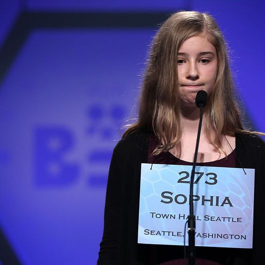 Sophia Limacher of Seattle, Washington, reacts after she misspelled her word in the round five of the 2013 Scripps National Spelling Bee May 30, 2013 at Gaylord National Resort and Convention Center in National Harbor, Maryland. Forty-two have advanced to the semifinal of the annual spelling contest for the championship.
