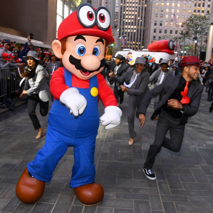 3dda8ac1618 A large Mario manifests in the corporeal world to dance with the plebeians.  Photo  Dave Kotinsky Getty Images for Nintendo of America