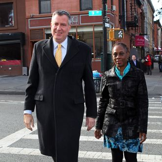 Bill Deblasio, Chirlane Deblasio,walk to the Park Slope branch of the Brooklyn Library to cast thier vote for the upcoming 2014 mayoral election.on November 5, 2013 in Brooklyn, New York City.