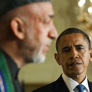 """US President Barak Obama (R) listens as Afghanistan President Hamid Karzai (L) speaks during a joint press conference at the White House in Washington, DC, May 12, 2010. President Obama noted Wednesday that visting Afghan counterpart Hamid Karzai had made progress on corruption but said """"much more"""" needed to be done in terms of good governance. AFP PHOTO/Jim WATSON (Photo credit should read JIM WATSON/AFP/Getty Images)"""