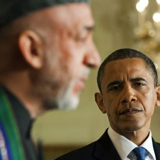 US President Barak Obama (R) listens as Afghanistan President Hamid Karzai (L) speaks during a joint press conference at the White House in Washington, DC, May 12, 2010. President Obama noted Wednesday that visting Afghan counterpart Hamid Karzai had made progress on corruption but said