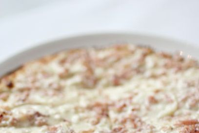 "<b>Tarte Flambée</b>    <a href=""http://nymag.com/listings/restaurant/bar-room/"">The Bar Room at the Modern</a>    <i>New York City</i>  It's debatable if tarte flambée, the classic thin-crust Alsatian dish, is technically <i>pizza</i>, but the designation is secondary to taste — and the dish sure tastes like a fantastic pizza. The country's best remains chef Gabriel Kreuther's, served inside MoMA. Pick from either the traditional version topped with crème fraîche, onions, and bacon; or an Americanized rendition with hen of the woods mushrooms, chives, and cheese from Vermont."