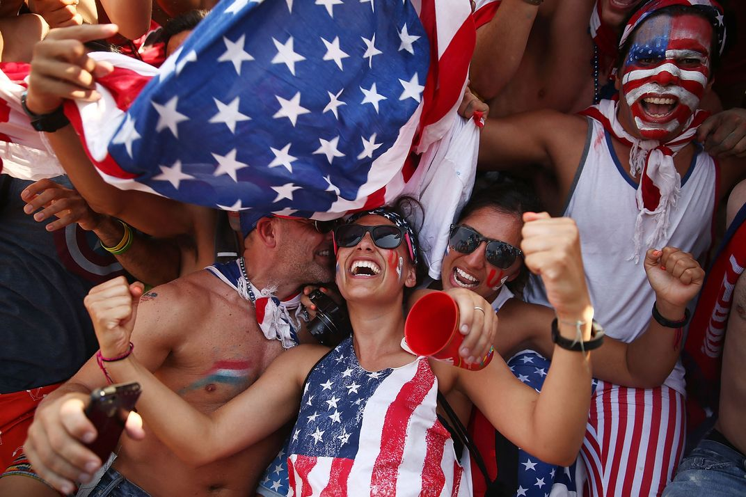 U.S. supporters celebrate after their loss to Germany after watching the match at FIFA Fan Fest on June 26, 2014 in Rio de Janeiro, Brazil. The U.S. lost 1-0 but still advance to the knockout stage of the 2014 FIFA World Cup based on goal differential.
