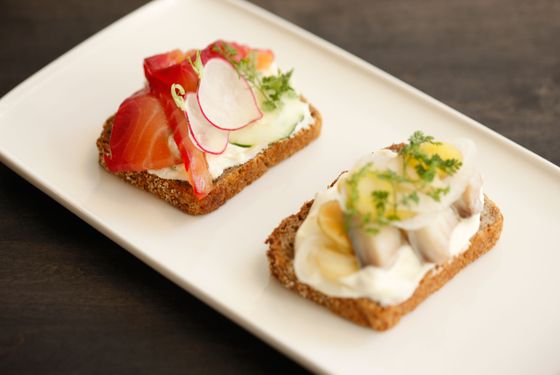 Rye bread tartines with beet-cured salmon and pickled mackarel.