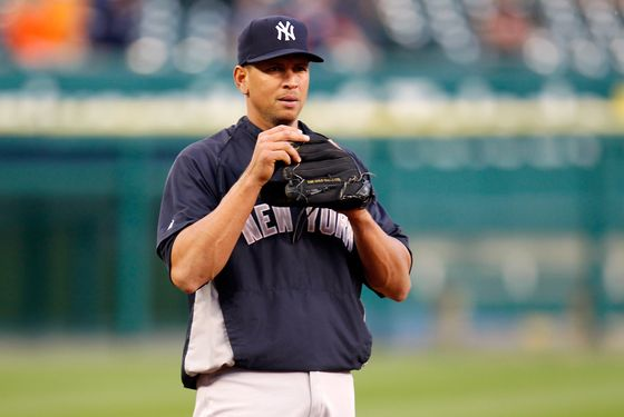Alex Rodriguez #13 of the New York Yankees looks on as he warms up against the Detroit Tigers during game four of the American League Championship Series at Comerica Park on October 17, 2012 in Detroit, Michigan.