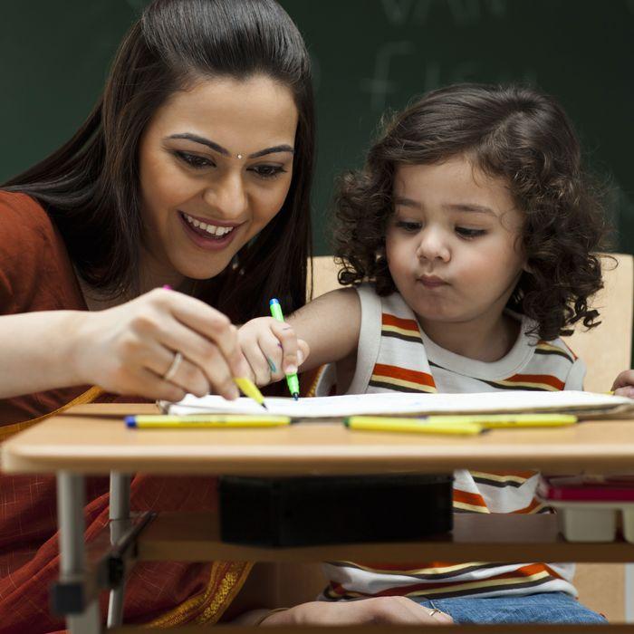 A teacher and a child.