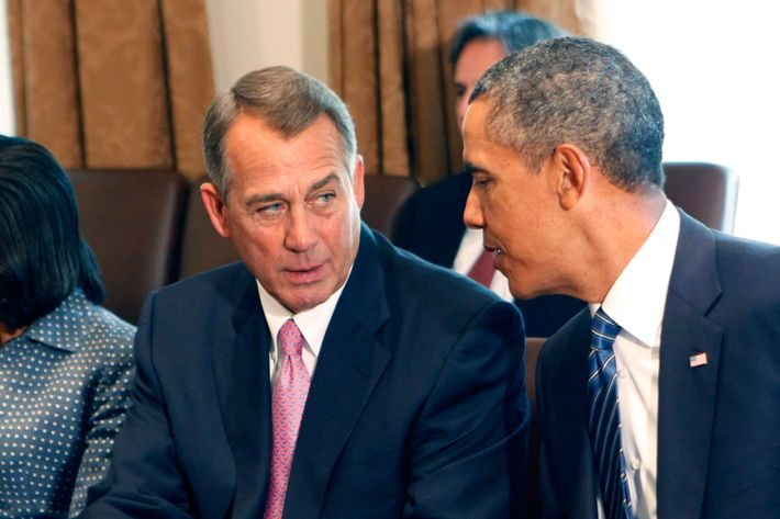 U.S. House Speaker John Boehner (R-OH) (L) speaks with U.S. President Barack Obama as he meets with members of Congress in the cabinet room of the White House on September 3, 2013 .