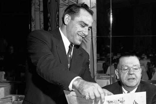 08 Nov 1949, St. Louis, Missouri, USA --- Original caption: New York Yankees' catcher, Yogi Berra, makes a few suggestions to a patron as he takes up his new job as host in a local restaurant.