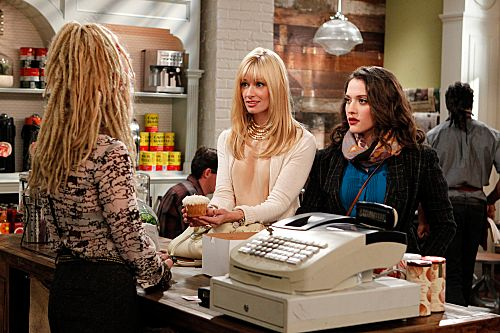 """""""And the Pretty Problem""""  -- Caroline (Beth Behrs, left) enrolls herself and Max (Kat Dennings, right) in a cake-decorating class to increase their skill level and take their cupcake business to the next level, on 2 BROKE GIRLS, Monday, Oct. 31 (8:30-9:00 PM, ET/PT) on the CBS Television Network. Photo: Sonja Flemming/CBS           ?2011 CBS Broadcasting Inc. All Rights Reserved."""