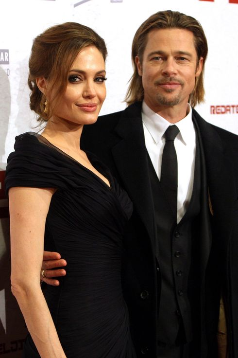 Angelina Jolie (L) and her partner, US actor Brad Pitt (R) arrive for the premiere of 'In the Land of Blood and Honey' at the Olympic Hall Zetra in Sarajevo, Bosnia and Herzegovina, 14 February 2012.