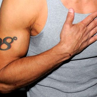 LAS VEGAS, NV - SEPTEMBER 04: Singer Jeff Timmons (tattoo detail) arrives at a pool party hosted by Sean