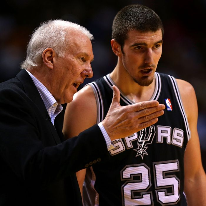 MIAMI, FL - NOVEMBER 29: Nando de Colo #25 of the San Antonio Spurs talks with head coach Greg Popovich during a game against the Miami Heat at American Airlines Arena on November 29, 2012 in Miami, Florida. (Photo by Mike Ehrmann/Getty Images)