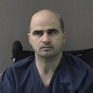 In this photo released by the Bell County Sheriff's Office, U.S. Maj. Nidal Hasan, the Army psychiatrist who is charged with nurder in the Fort Hood shootings, is seen in a booking photo after being moved to the Bell County Jail on April 9, 2010 in Belton, Texas. Hasan was transferred early April 9, 2010 from Brooke Army Medical Center in San Antonio to Bell County Jail in Belton, Texas.