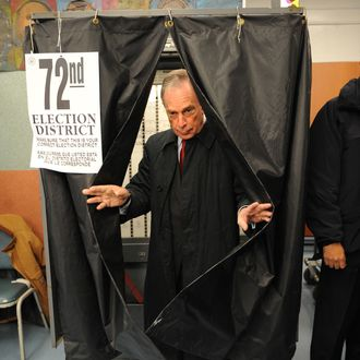 New York City Mayor Michael Bloomberg emerges from a voting booth after casting his ballot November 3, 2009 at an elementary school in New York in bid to win a third term as mayor of New York City against Democratic opponent William C.Thompson, Jr.