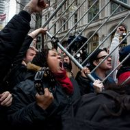 Demonstrators from the Occupy Wall Street movement lift a police barricade at Zucotti park in New York, U.S., on Thursday, Nov. 17, 2011. New York police stood prepared for tens of thousands of Occupy Wall Street demonstrators to descend on the Financial District, and ringed the area with metal barricades to deter crowds from reaching their goal of surrounding the New York Stock Exchange. Photographer: Scott Eells/Bloomberg via Getty Images