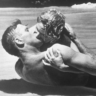 1953 --- American actor Burt Lancaster and Scottish actress Deborah Kerr on the set of From Here to Eternity, directed by Fred Zinnemann.