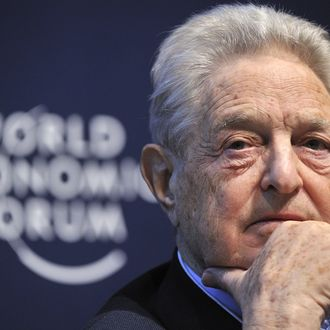 A Hungarian-American financier George Soros looks on during a session entitled