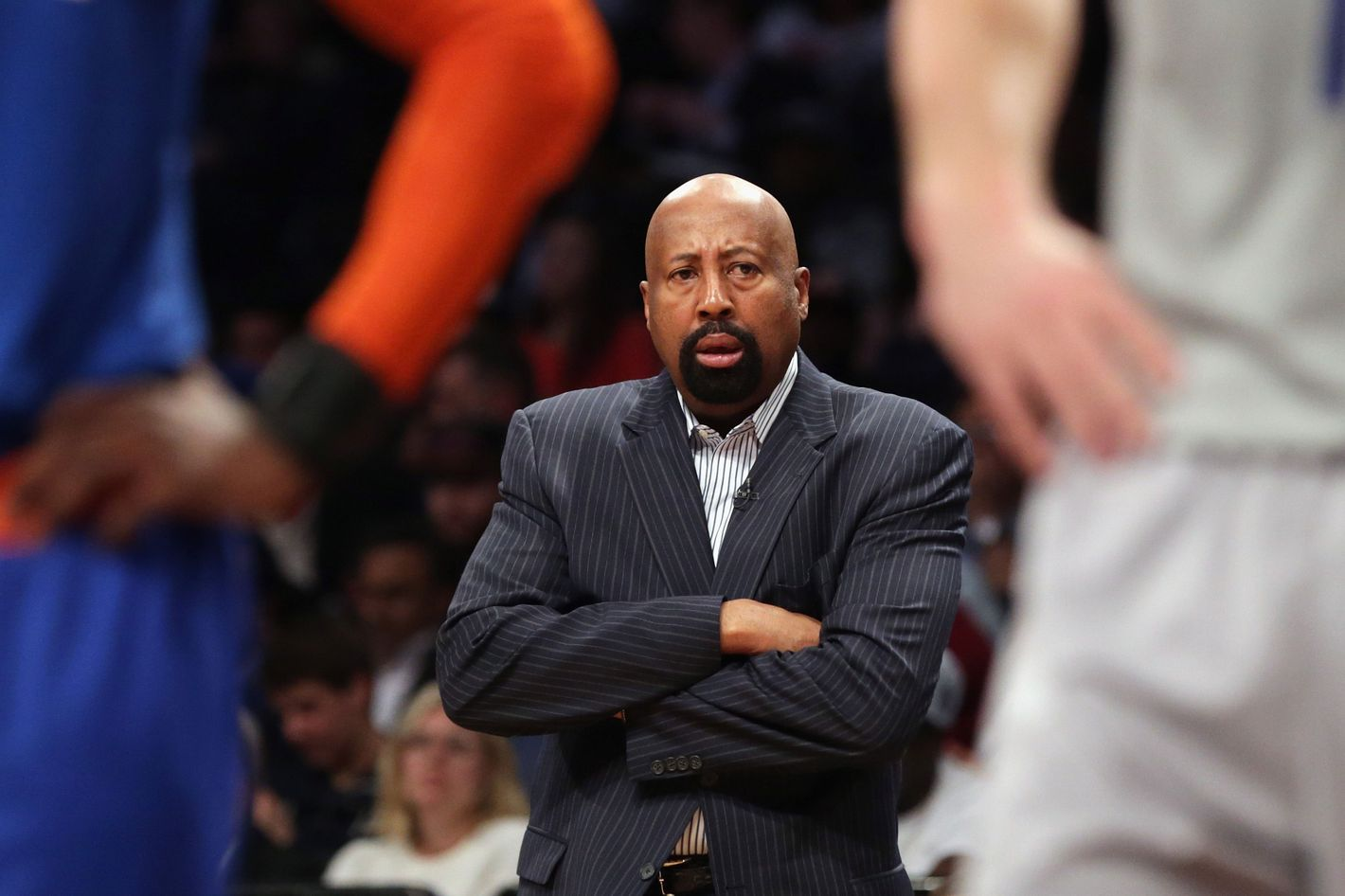 Mike Woodson of the New York Knicks handles bench duties during the game against the Brooklyn Nets at the Barclays Center on April 15, 2014 in the Brooklyn borough of New York City.