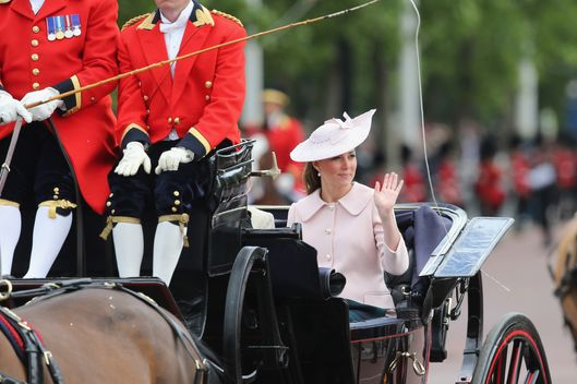 Catherine, Duchess of Cambridge heads along the Mall towards Buckingham Palace during the annual Trooping the Colour Ceremony on June 15, 2013 in London, England. Today's ceremony which marks the Queens official birthday will not be attended by Prince Philip the Duke of Edinburgh as he recuperates from abdominal surgery and will also be The Duchess of Cambridge's last public engagement before her baby is due to be born next month.