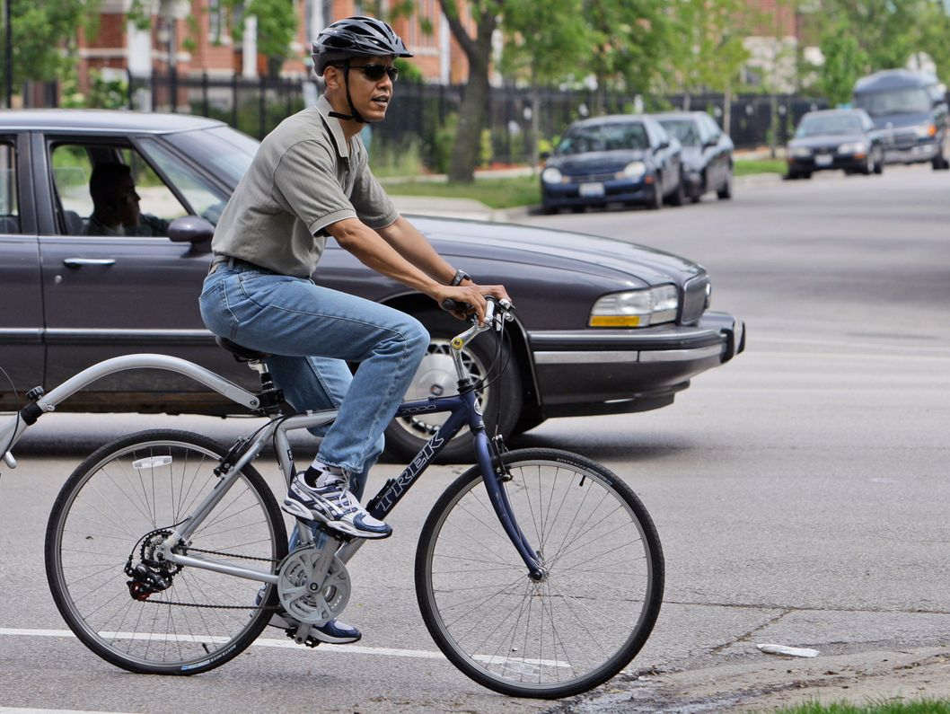 08 Jun 2008, Chicago, Illinois, USA --- Democratic presidential candidate Sen. Barack Obama, D-Ill., goes for a bike ride in Chicago, Sunday, June 8, 2008.(AP Photo/Alex Brandon) --- Image by ? Alex Brandon/AP/Corbis