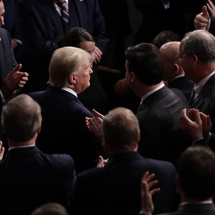 U.S. President Donald Trump, center, arrives to deliver a State of the Union address to a joint session of Congress at the U.S. Capitol in Washington, D.C., U.S., on Tuesday, Feb. 4, 2020.