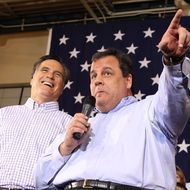 Republican presidential candidate former Massachusetts Gov. Mitt Romney (L) looks on as New Jersey Gov. Chris Christie (R) speaks during a rally at Exeter High School on January 8, 2012 in Exeter, New Hampshire.