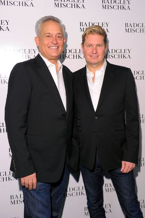 Designers Mark Badgley and James Mischka pose backstage at the Badgley Mischka Fall 2013 fashion show during Mercedes-Benz Fashion Week at The Theatre at Lincoln Center on February 12, 2013 in New York City.