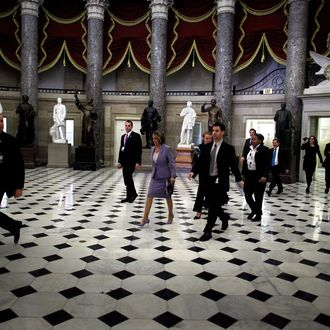 Speaker of the House Nancy Pelosi (D-CA) (C) walks through Statuary Hall on her way to the House Chamber ahead of a historic vote on health care reform at the U.S. Capitoll March 21, 2010 in Washington, DC.