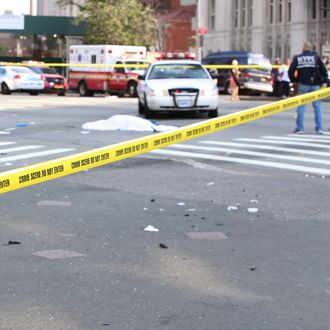 Crime scene tape blocks intersection of Fourth, Flatbush and Atlantic Aves with covered body of a bicyclist who was fatally struck by SUV witnesses said was attempting to flee the scene of an accident on Fourth and Dean Aves in Brooklyn on July 13, 2015