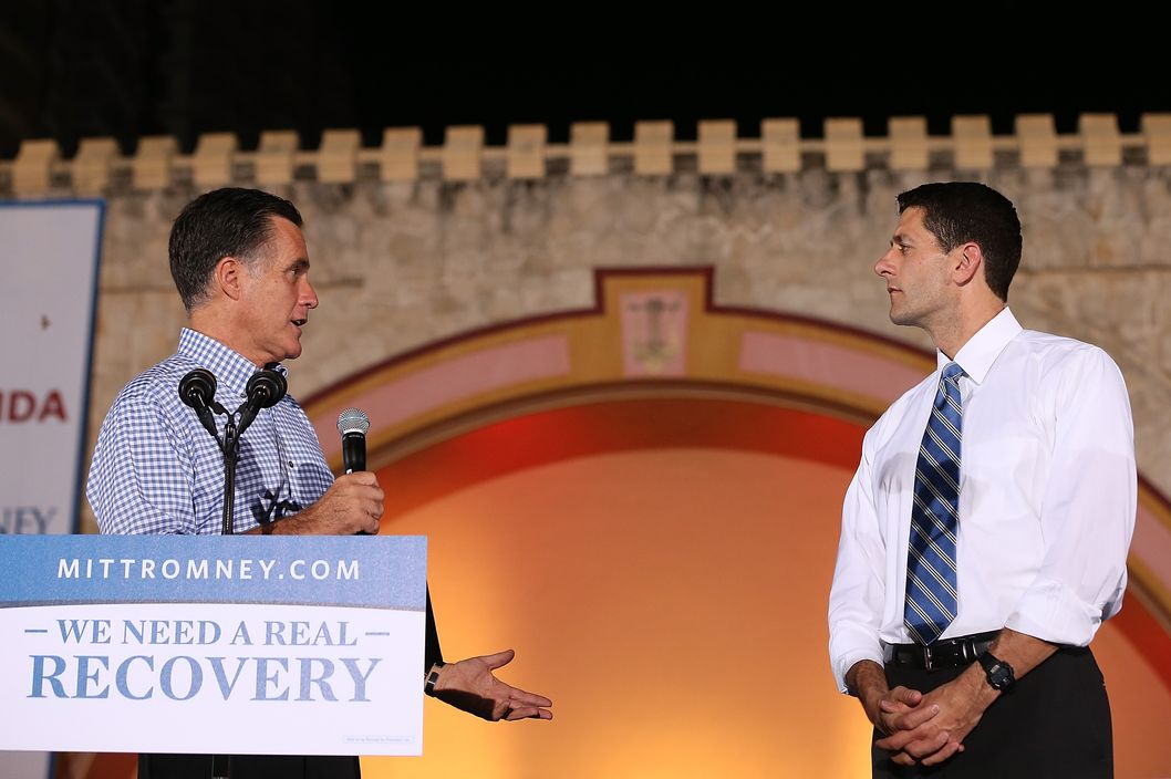 DAYTONA BEACH, FL - OCTOBER 19:  Republican presidential candidate Mitt Romney (L) speaks as Republican vice presidential candidate, U.S. Rep Paul Ryan (R-WI) looks on during a Victory Rally at the Daytona Beach Bandshell on October 19, 2012 in Daytona Beach, Florida. Romney is in Florida over the weekend to prepare for the third and final debate with U.S. President Barack Obama.  (Photo by Justin Sullivan/Getty Images)